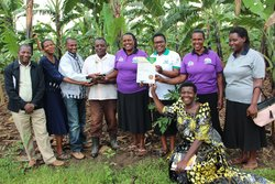 A team from Bioversity and NARO pose for a photo with Joy Mugisha. Credit: Bioversity International/J.Turyatemba
