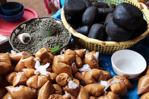 Groundnut paste and néré (black) for sale in market, Ghana. Neré is a local seasoning paste made from a wild tree. Credit: Bioversity International/C. Zanzanaini