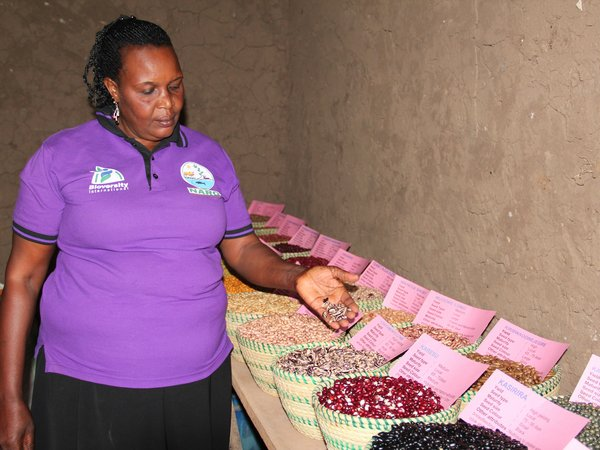 Joy Mugisha in her home seedbank. Credit: Bioversity International/J.Turyatemba