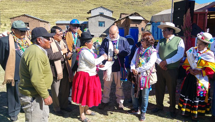 Farming communities attending rewards (in-kind and social recognition) handover ceremony for successful conservation of rare quinoa varieties. Huataquita, Puno Region, Peru. Credit: Bioversity International/A.Drucker