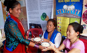 Woman tries a dish made out of local ingredients at the 'Food Fair 2016' event in Nepal.